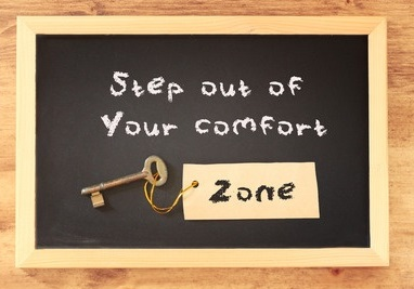 30358233 - the phrase step out of your comfort zone written on blackboard